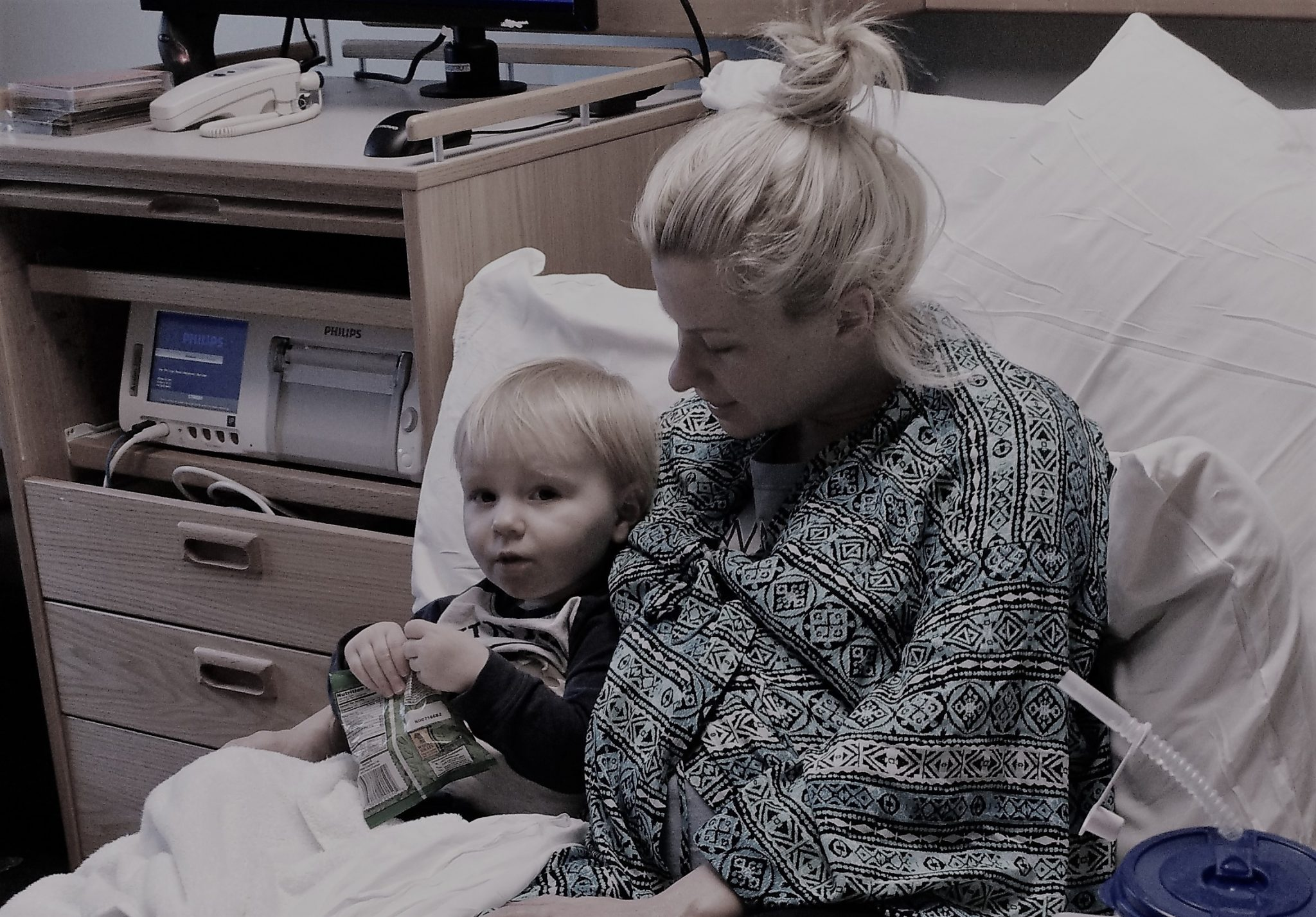 Theo and Mommy watching a movie in the hospital the day before the birth of Josie and Margo