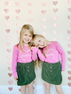 picture of two little girls who are identical twins hugging