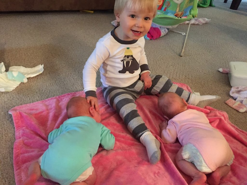 Preemie twins with big brother.