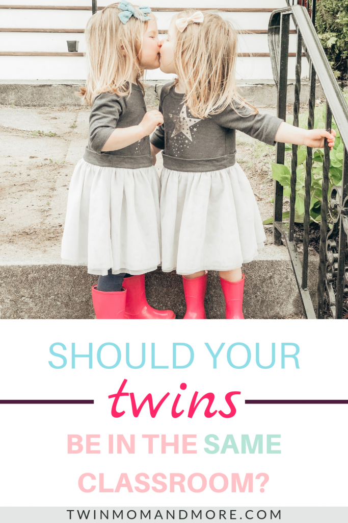 Identical preschool aged twin girls standing on porch steps giving each other a kiss. They are wearing tutu dresses and hot pink rainbows. Text reads should your twins be in the same classroom?
