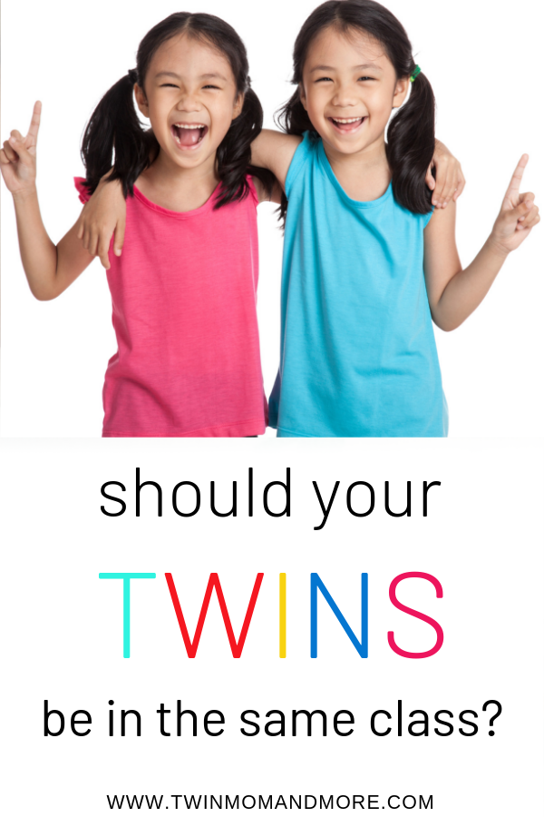 Pinterest image of two 7 year old asian twin girls in pig tails. The girls have their arms around each other and are each holding up their index finger. One twin is wearing a pink t shirt and the other one is wearing blue. Text reads Should your Twins be in the same class?