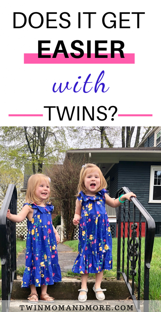 Pinterest image with text: Does it get easier with twins? Image of identical three year old twin girls in floral dresses.