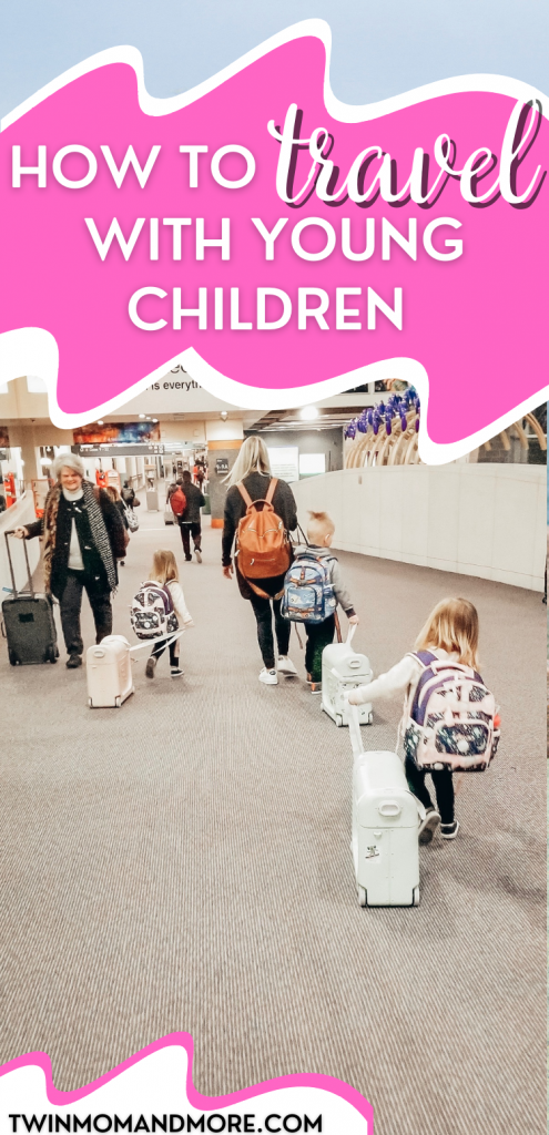 Pinterest image of mom with young children walking through the airport traveling with young children.