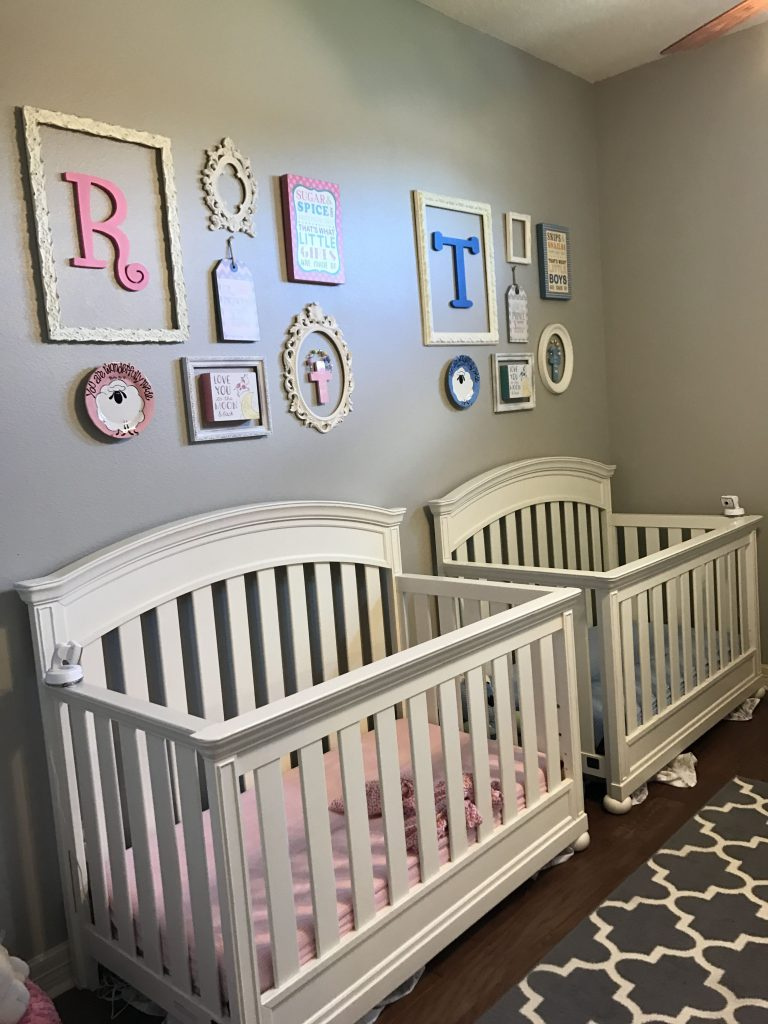 Classic boy girl twin nursery with white cribs.