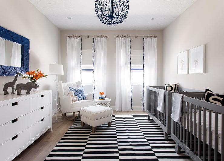 Classic and modern navy blue and white twin boy nursery.
