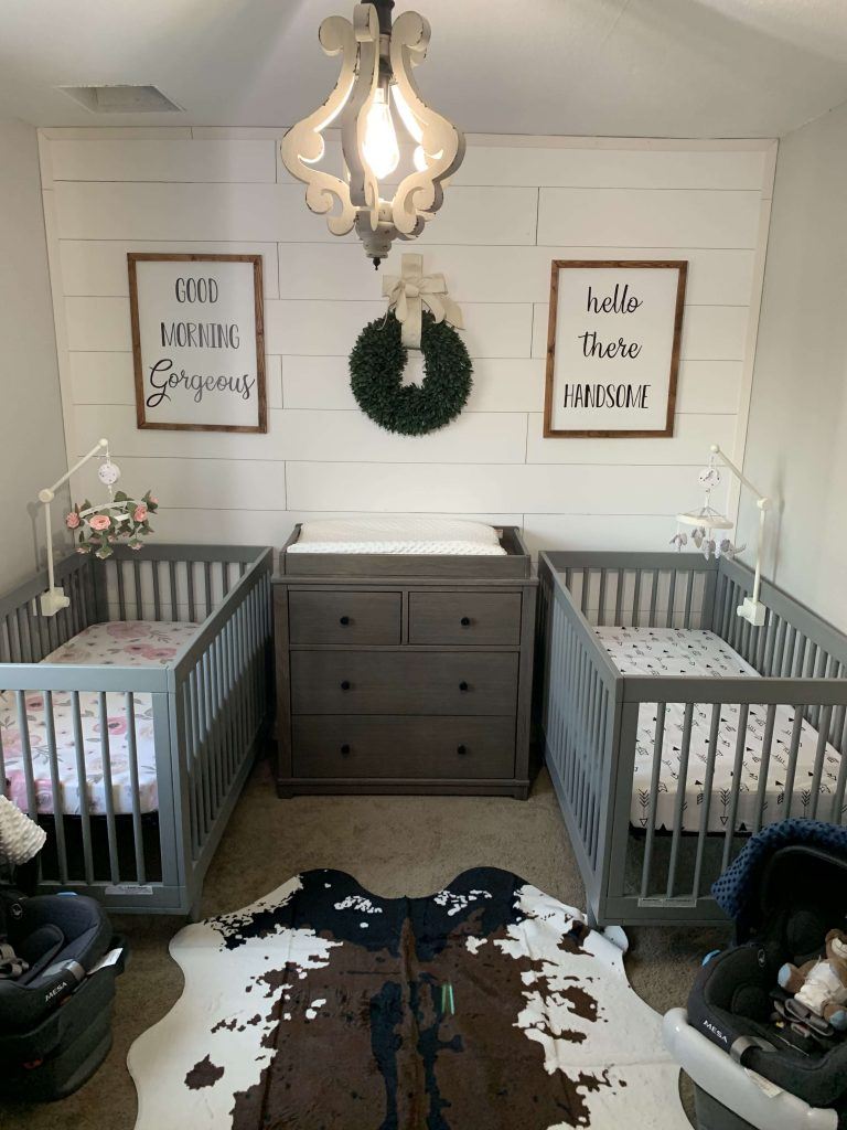 Classic and modern twin nursery inspiration with dark gray cribs and shiplap walls.