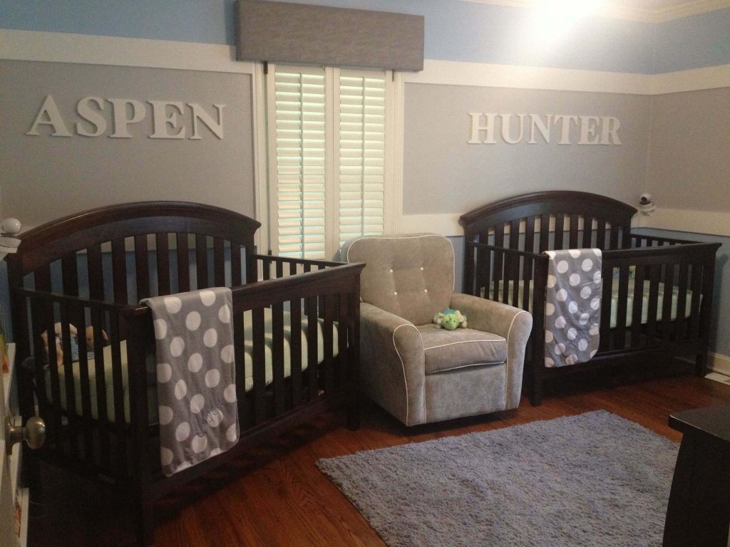 Small space twin boy nursery with dark brown cribs.