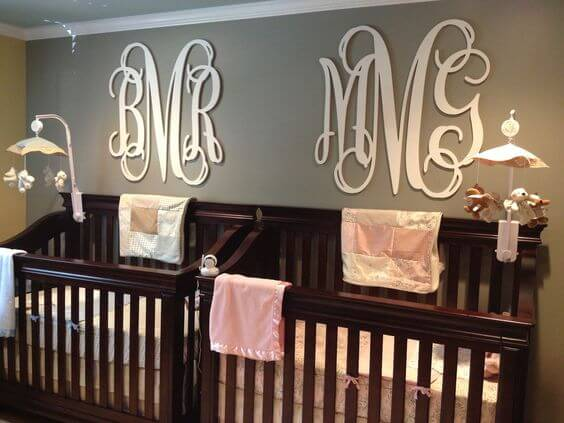 Classic girl boy twin nursery with dark brown cribs.