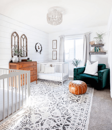 Gender neutral twin nursery that is modern and glamorous with shiplap walls and a chandelier.