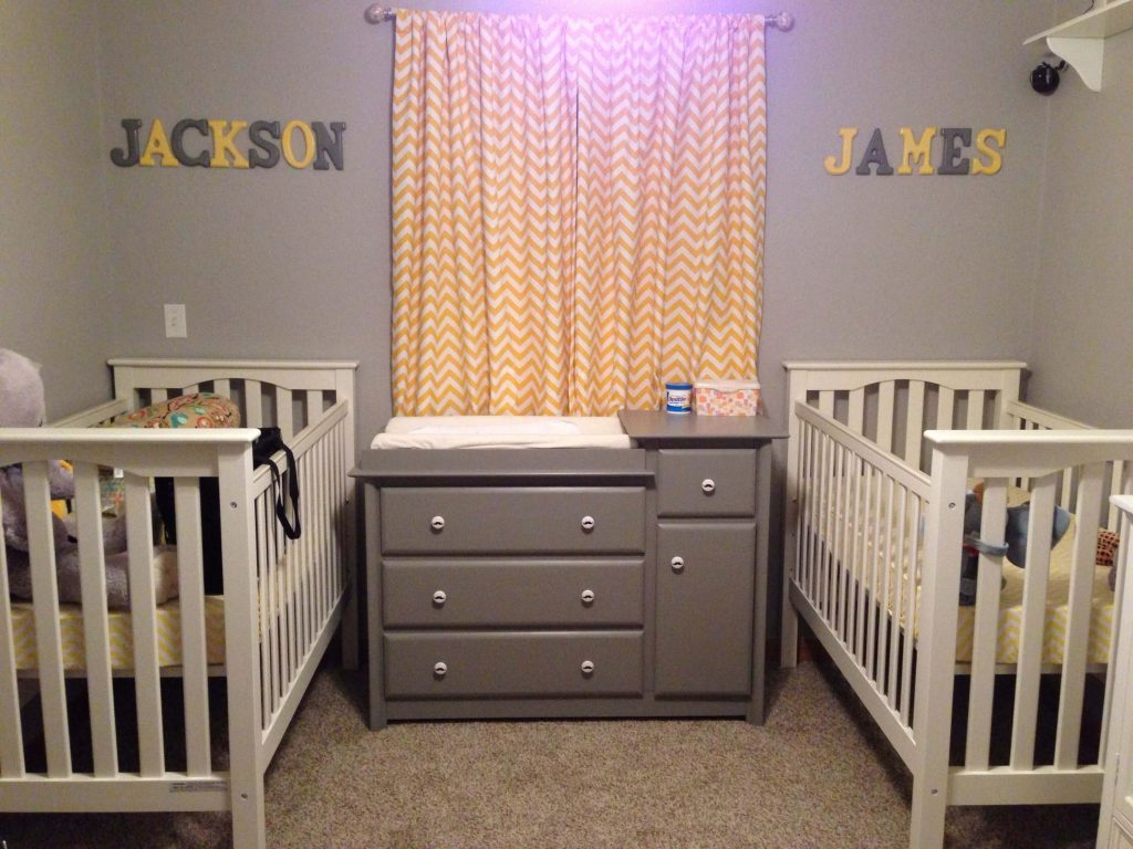 Classic yellow and gray nursery for twin boys.