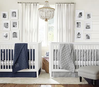Classic twin boy nursery room in navy and white.