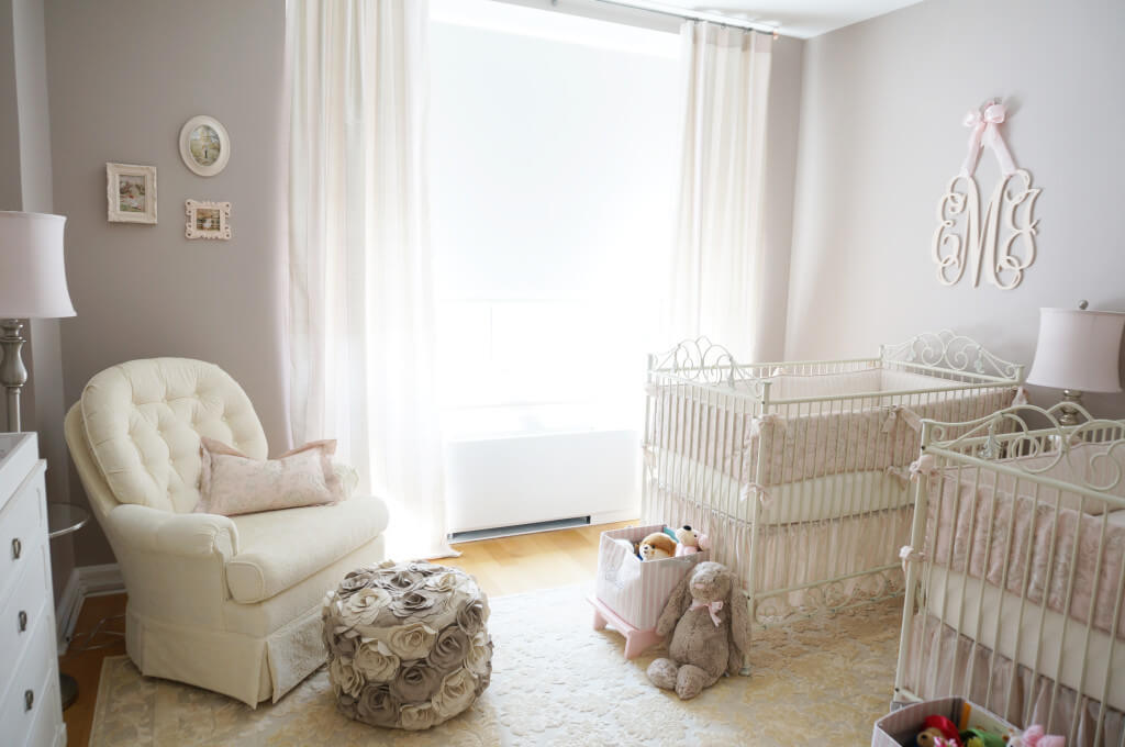 Twin girl nursery that's elegant with ivory and light pink.