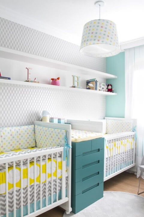 Twin boy nursery that's yellow and teal.